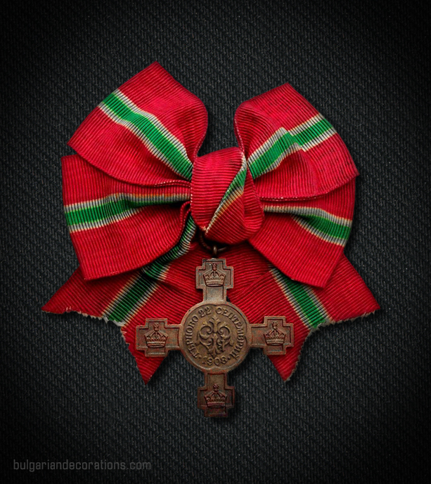 Cross with bow-shaped ribbon, overse